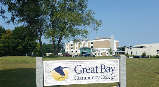 Great Bay Community College building with sign